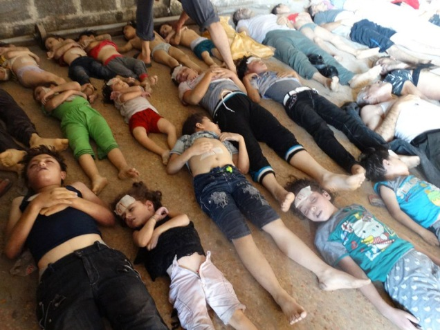 GRAPHIC CONTENT A handout image released by the Syrian opposition's Shaam News Network shows bodies of children and adults laying on the ground as Syrian rebels claim they were killed in a toxic gas attack by pro-government forces in eastern Ghouta, on the outskirts of Damascus on August 21, 2013. The allegation of chemical weapons being used in the heavily-populated areas came on the second day of a mission to Syria by UN inspectors. It was promptly denied by the Syrian authorities. AFP PHOTO/HO/SHAAM NEWS NETWORK == RESTRICTED TO EDITORIAL USE - MANDATORY CREDIT